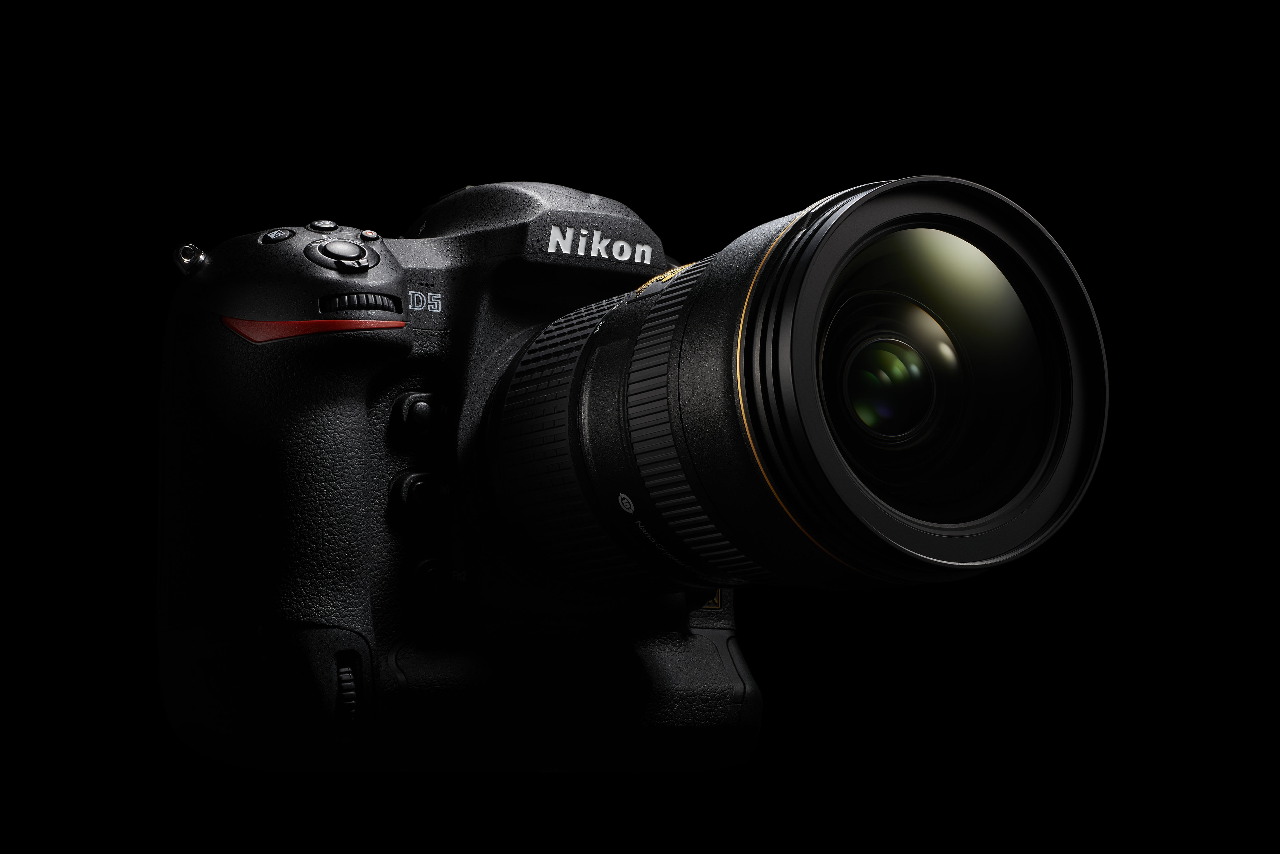 Nikon D5 in front of black background.